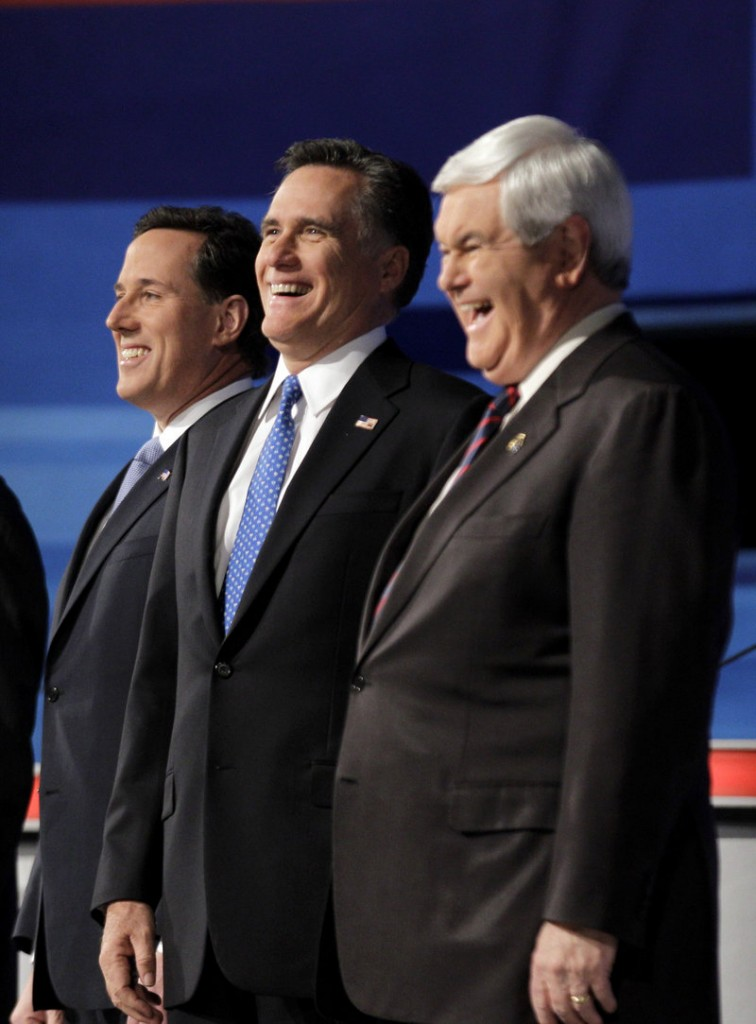 In the runup to the Illinois GOP presidential primary Tuesday, Mitt Romney, center, is pouring millions into advertising. A poll last week put Rick Santorum, left, within striking distance of Romney there, while Newt Gingrich is planting doubts about Romney.