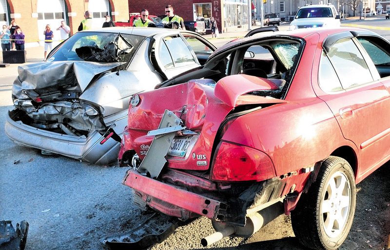 These two vehicles were rear-ended along with three other vehicles waiting at a traffic light at College Avenue and Main Street in Waterville on Sunday, sending several occupants to the hospital.
