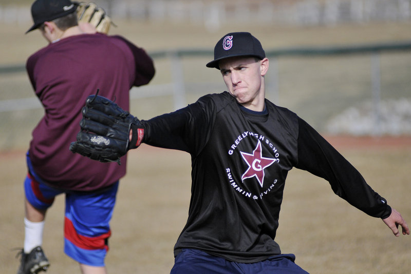 Connor Russell, a Greely pitcher, practices his technique during practice Monday in Cumberland.