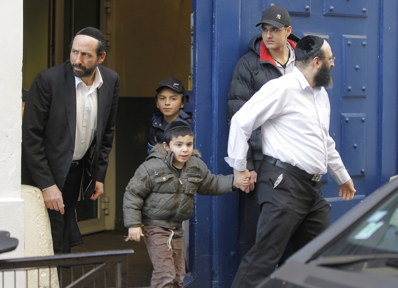 French schoolchildren leave a Jewish school in Paris on Monday, after the French interior minister ordered security to be tightened around all French Jewish schools following an attack on one in Toulouse. A father and his two sons were among four people who died.