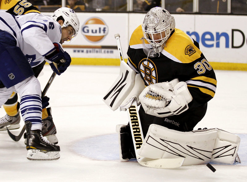 Tim Thomas faced just 13 shots, and this was one of them, a save on Toronto's Clarke MacArthur in Monday's game at Boston. The Bruins crushed the Maple Leafs 8-0, winning all six games with Toronto this season.