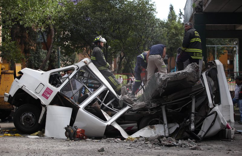 In Mexico City, earthquake damage included a pedestrian bridge that collapsed on an empty transit bus.