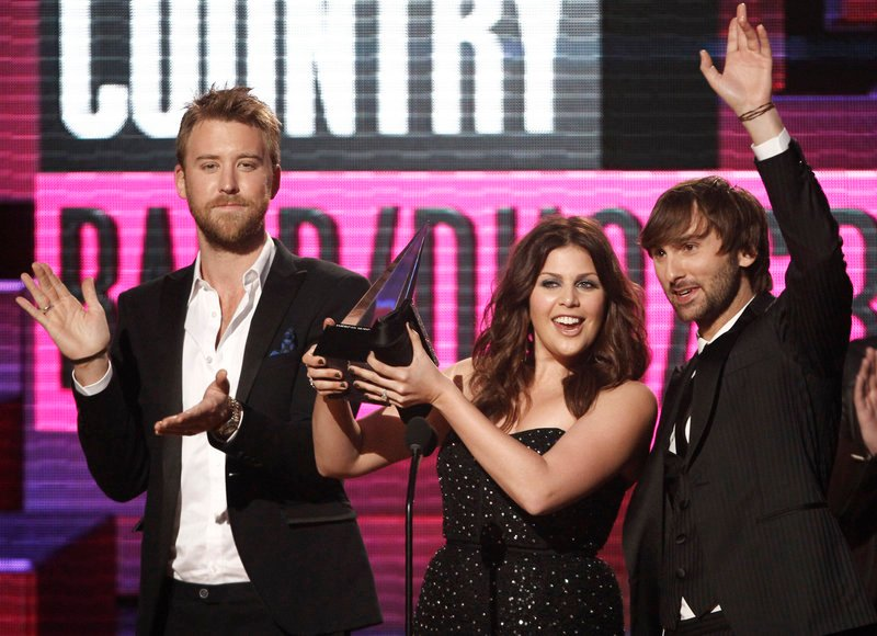 Lady Antebellum group members from left, Charles Kelley, Hillary Scott and Dave Haywood. The band said it was touched by Henryville's resilience and unity.