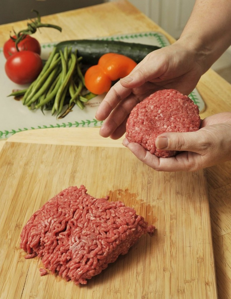 Don't put cooked hamburger patties on the same plate as raw meat.
