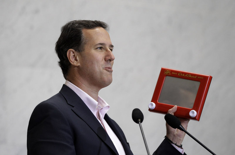 Former Sen. Rick Santorum holds an Etch A Sketch as he speaks to USAA employees during a campaign stop Thursday in San Antonio.
