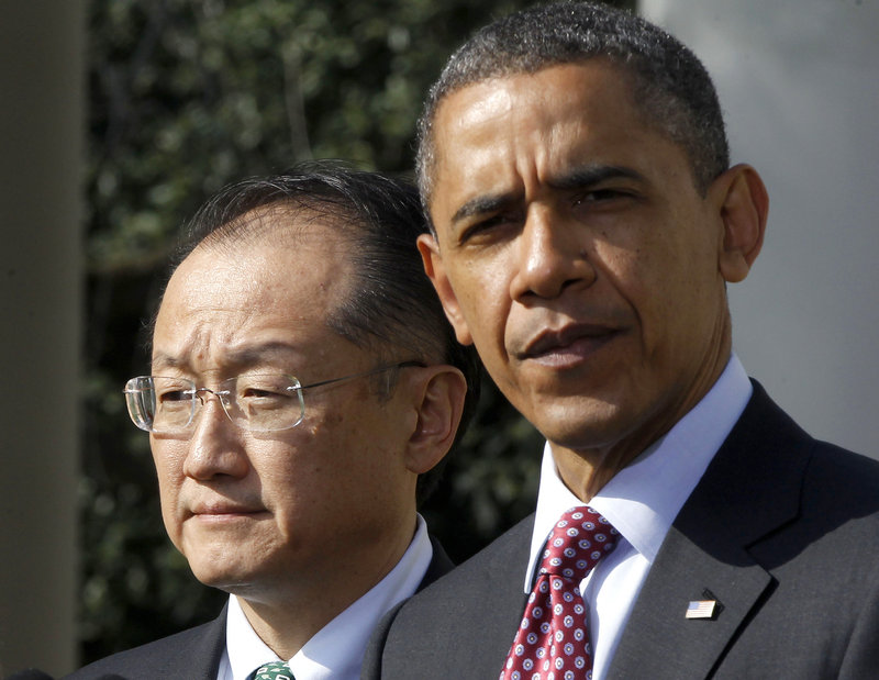 President Barack Obama stands with Jim Yong Kim, his nominee to be the next World Bank president, in the Rose Garden of the White House on Friday.