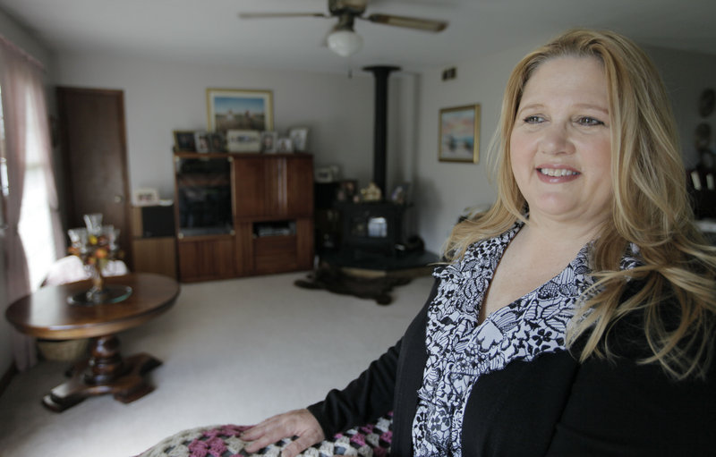 Michelle Chesney-Offutt is shown in her home before leaving for work as an insurance customer service representative in Sandwich, Ill. Chesney-Offutt, who was unemployed for nearly three years, said a recruiter who responded to her online resume two years ago backed off when he learned she had been jobless for 13 months.