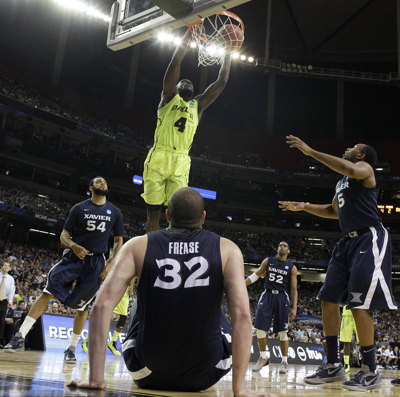 Quincy Acy, who scored 20 points to go with 15 rebounds for Baylor, dunks the ball in front of the fallen Kenny Frease in the second half Friday night, and the Bears advanced to the regional final with a 75-70 victory.