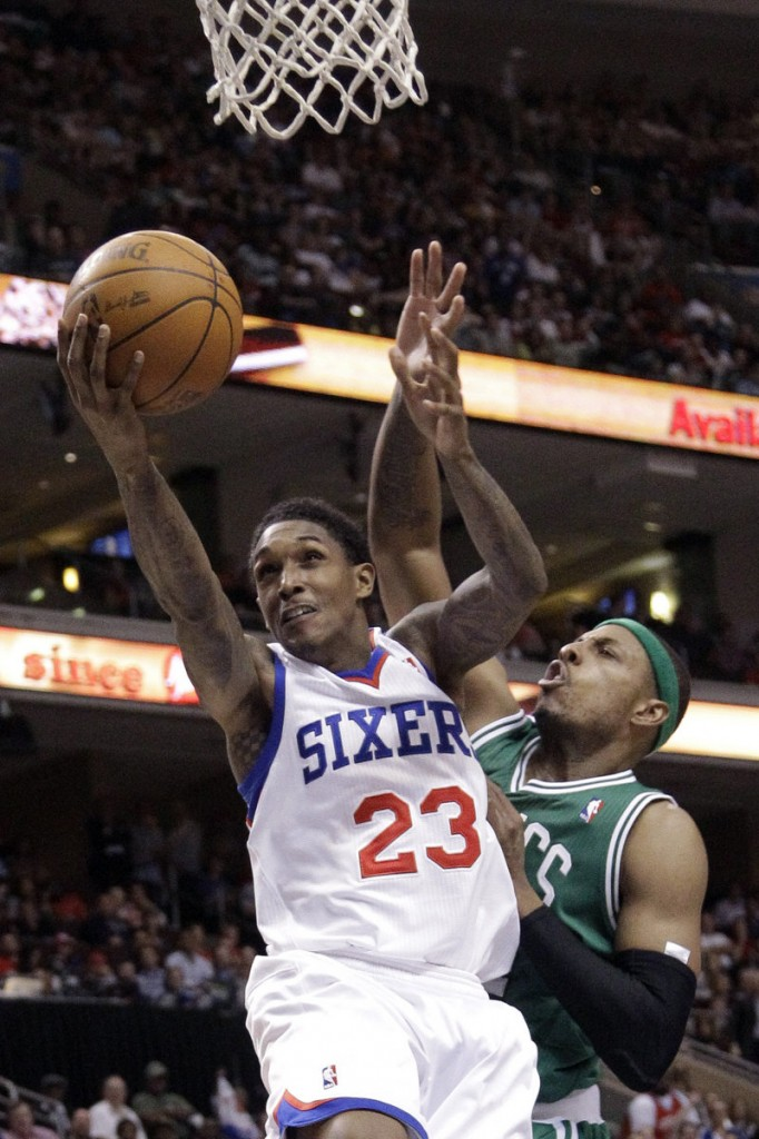 Lou Williams of the Philadelphia 76ers goes up for a shot against Paul Pierce of the Boston Celtics during the second half of the 76ers' 99-86 victory Friday night.
