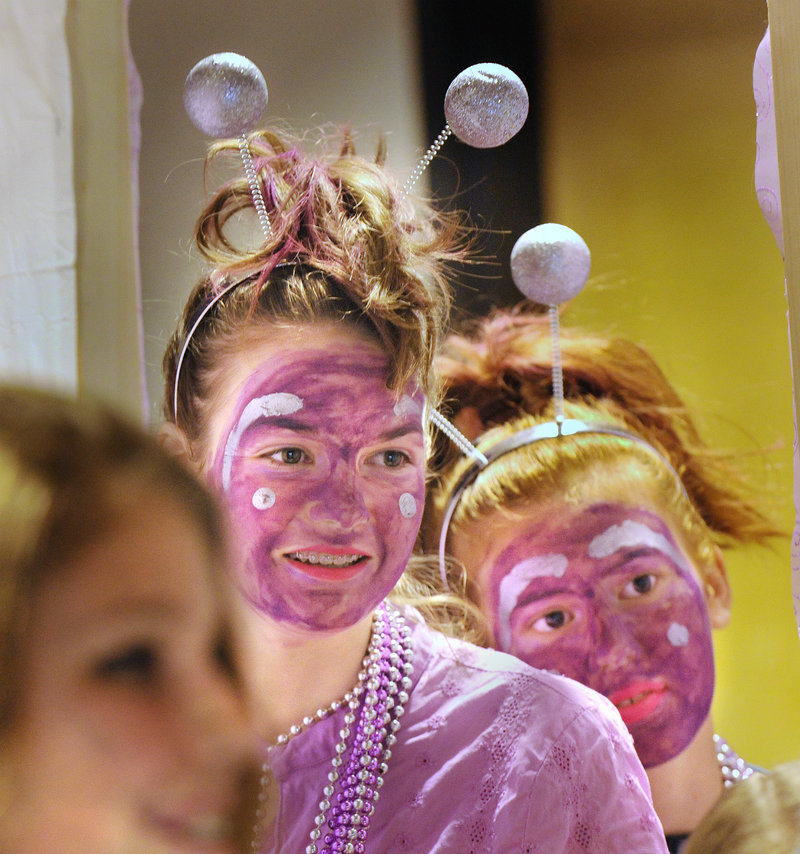 "Amelia Lorrey, left, and Olivia Stites, students at the Shapleigh School, await their team's turn onstage for their ""Odyssey Angels"" performance at the Odyssey of the Mind tournament."