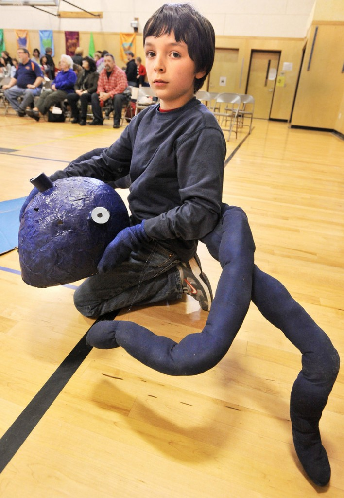 Reed Henderson of Gorham's Narragansett School team plays the role of an octopus during the Ohh-Motional Vehicle competition.