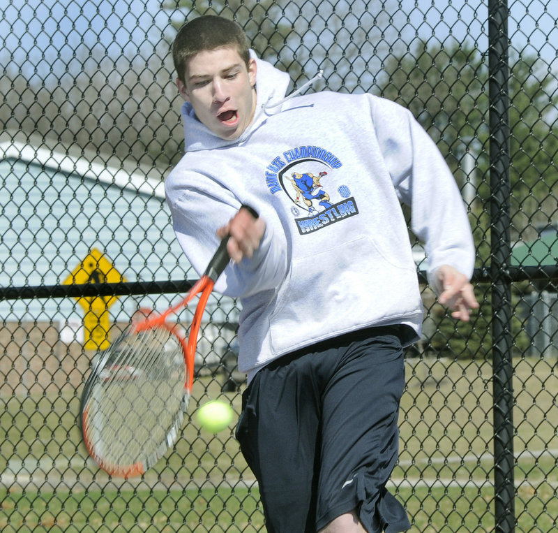 Devin Pelletier, one of Windham's top doubles players last year, hits a shot during the opening practice session.