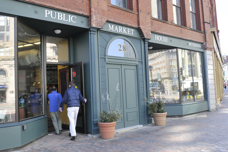 Customers head into the Public Market House, a combination of food vendors and specialty stores.