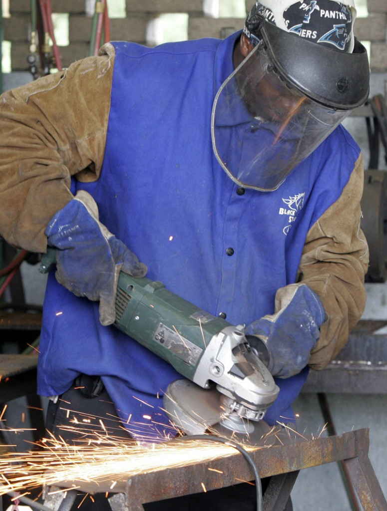 A student uses a grinder during welding class at Midlands Technical College in Columbia, S.C. Manufacturing has become complex, and so has the mathematics involved.