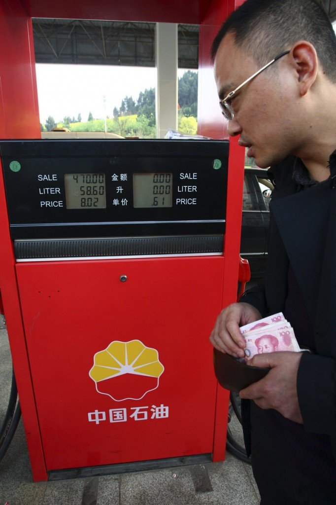 A customer in China's southwestern province of Sichuan prepares to pay for gas at a PetroChina gas station this week. PetroChina is now pumping more oil than Exxon Mobil.