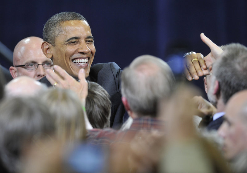 President Barack Obama greets well-wishers after his speech at Southern Maine Community College in South Portland on Friday. His half-hour address sought to rally his base while denouncing Republican policies.