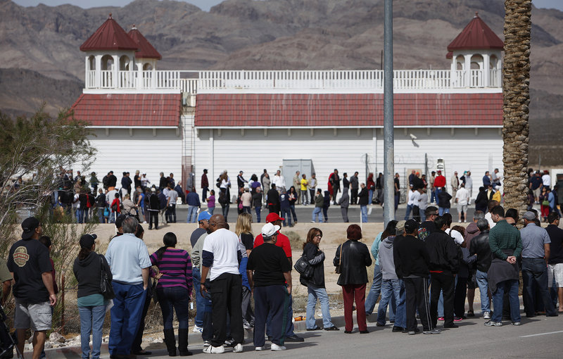 People wait in line to buy tickets for the Mega Millions lottery jackpot at the Primm Valley Casino Resorts Lotto Store in California near Primm, Nev., Thursday.