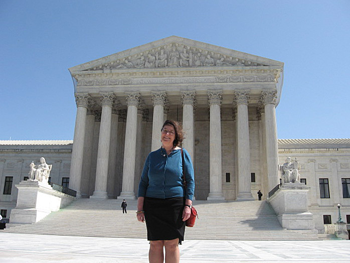State Rep. Sharon Anglin Treat, D-Hallowell, stands in front of the Supreme Court today.