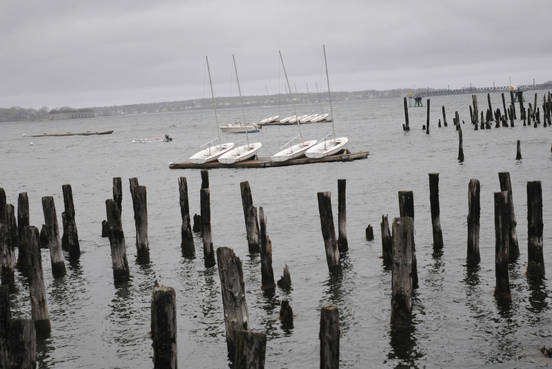 Boats sit on a dock in the choppy water on the eastern end of Portland Harbor on Sunday. The National Weather Service is calling for 2 to 3 inches of rain by the end of today.