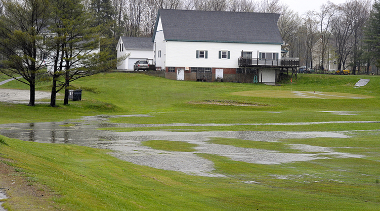 No golf today at the Twin Falls Golf Club in Westbrook as heavy rains flood the course, making pools of water on the fairways and greens.