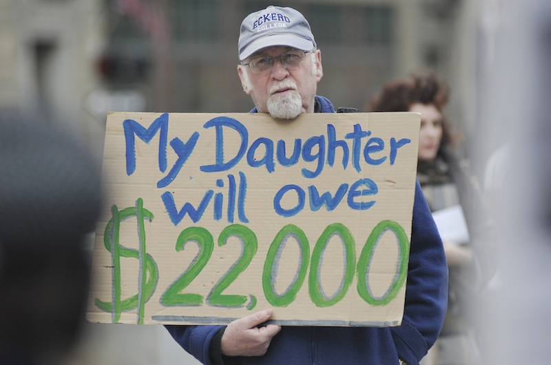 Val Hart of Cumberland participates in a protest in Monument Square in Portland against high student debt Wednesday, April 25, 2012. Hart was one of about 20 protesters at the demonstration, which was organized by Occupy Maine.