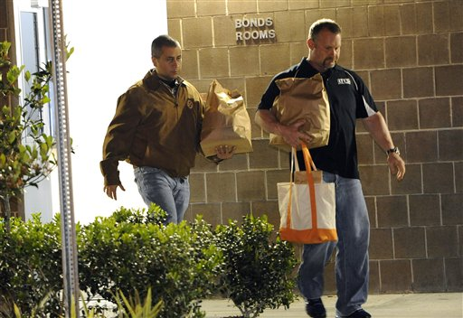 George Zimmerman, left, walks out of the intake building at the John E. Polk Correctional Facility with a bondsman late Sunday in Sanford, Fla.