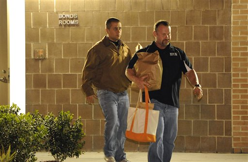 George Zimmerman, left, walks out of the intake building at the John E. Polk Correctional Facility with an unidentified man on Sunday in Sanford, Fla. Zimmerman posted bail on a $150,000 bond on a second-degree murder charge in the February shooting death of 17 year-old Trayvon Martin.
