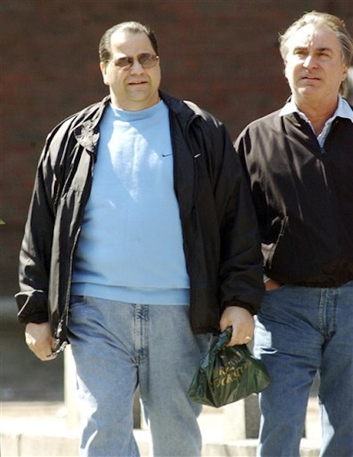 This March 25, 2002 photo shows Carmen Anthony DiNunzio, left, walking with Anthony Gambale, right, on Hanover Street in Boston's North End. A spokesman for the Rhode Island U.S. Attorney's Office said Anthony DiNunzio was taken into FBI custody and is scheduled to be in federal court in Providence, R.I., Wednesday afternoon April 25, 2012. (AP Photo/Boston Herald, Kevin Wisniewski)
