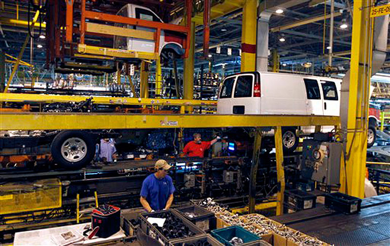 In this Nov. 3, 2011, file photo, General Motors employees work on a van assembly line at GM's plant in Wentzville, Mo. The U.S. auto industry, already stretched to meet growing car and truck sales, faces parts shortages that could limit the number of new vehicles in showrooms later this year and crimp a historic turnaround. The most immediate problem, the shortage of a crucial plastic resin, could surface in few weeks. And later in the year, automakers could face an even bigger crisis, running short of parts simply because there aren't enough factories and people left to make them. (AP Photo/Jeff Roberson, File)