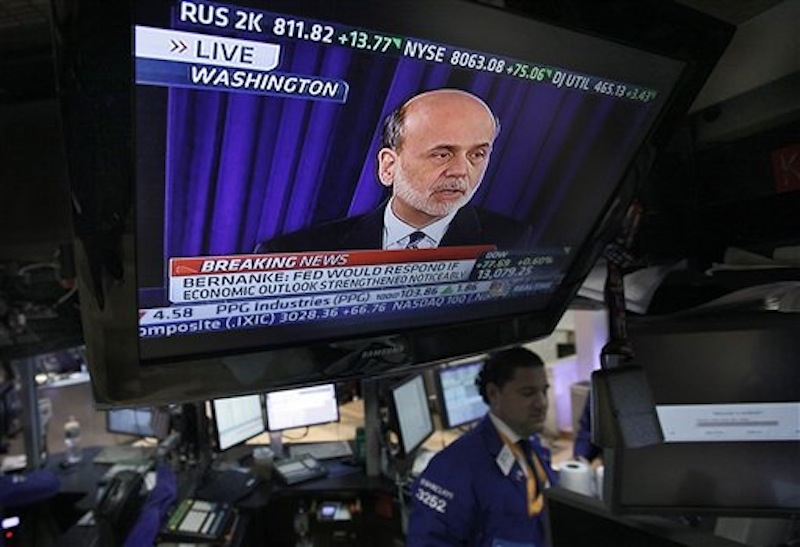 Federal Reserve Chairman Ben Bernanke is broadcast on a television screen on the trading floor of the New York Stock Exchange, Wednesday, April 25, 2012. Bernanke says further bond purchases by the Fed remain