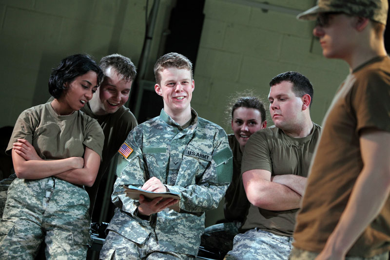 In this photo provided by the National Theatre Wales, on Friday April 20, 2012 Matthew Aubrey,center, plays U.S. Army Pfc. Bradley Manning in the play