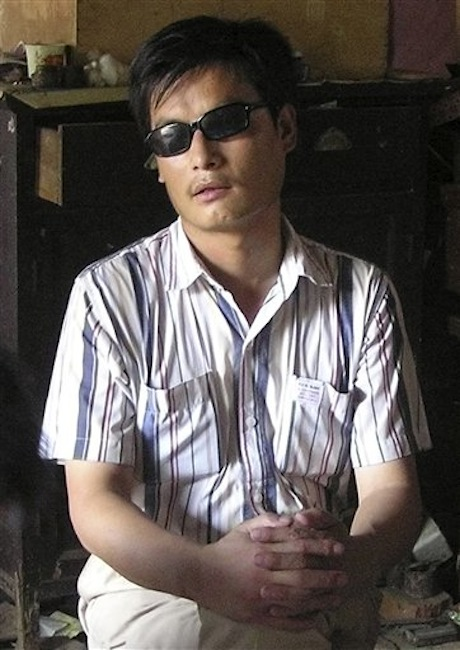 In this undated file photo released by his supporters, blind activist Chen Guangcheng sits in a village in China. Rights campaigners said Friday, April 27, 2012 that Chen, a leading figure in China's rights movement, has escaped the house arrest he lived under for 18 months in Shandong province. (AP Photo/Supporters of Chen Guangcheng, File)