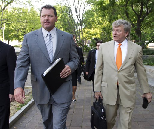 Former Major League Baseball pitcher Roger Clemens and his attorney, Rusty Hardin, arrive at federal court in Washington on Monday.