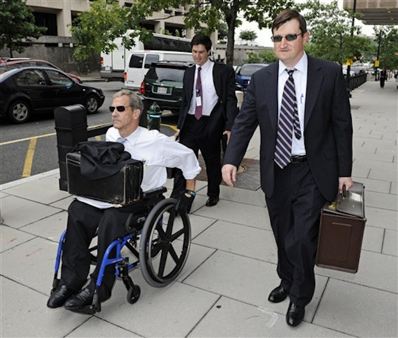 In this July 13, 2011 photo, Assistant U.S. Attorneys Daniel Butler, left, and Steve Durham, leave federal court in Washington. On a baseball field, players back up teammates to limit the damage from errors. The Justice Department, embarrassed by an error that caused a mistrial of Roger Clemens last year, has added more prosecutors in hopes of containing any missteps as it seeks to convict the famed pitcher of lying to Congress when he said he never used performance-enhancing drugs. (AP Photo/Cliff Owen)