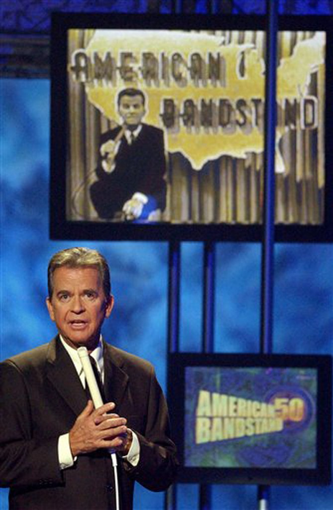 In this April 20, 2002 file photo, Dick Clark, host of the American Bandstand television show, introduces entertainer Michael Jackson on stage during taping of the show's 50th anniversary special in Pasadena, Calif. Clark, the television host who helped bring rock `n' roll into the mainstream on