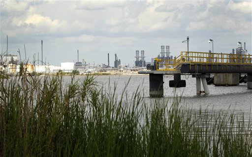 This photo taken April 13, 2012, shows a view of a plant near the approximate site of the former Olin-Matheison plant in Lake Charles, La. The view was originally photographed for the