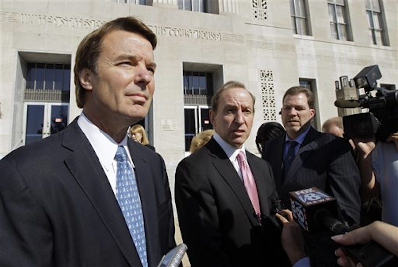 In this Oct. 27, 2011 file photo, former U.S. Sen. and presidential candidate John Edwards, left, speaks to the media with attorney Abbe Lowell, right, as he leaves the federal court in Greensboro, N.C. Prosecutors and defense lawyers in the John Edwards trial were poised Monday April 23, 2011 to begin making their case to jurors on whether the former presidential candidate violated federal campaign finance laws. (AP Photo/Chuck Burton, File)