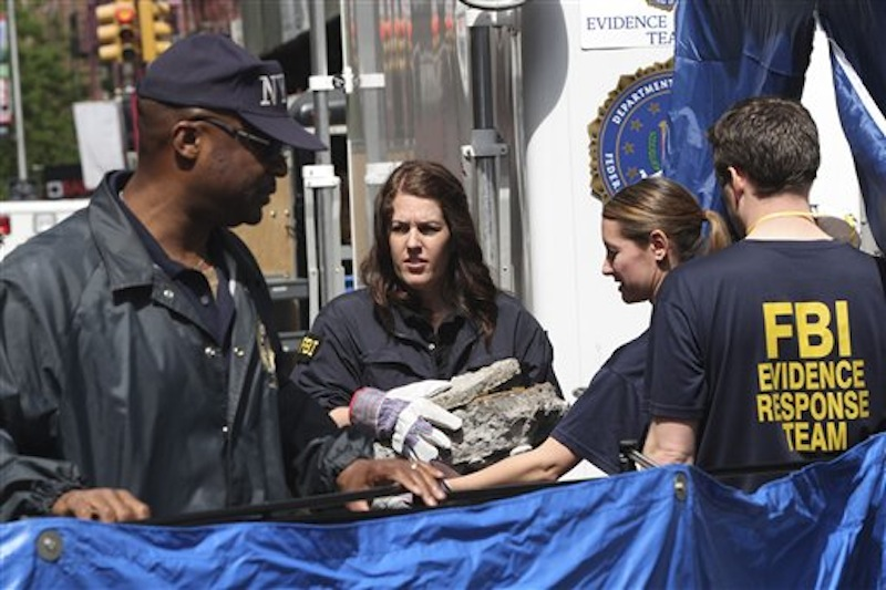 Members of the FBI team carry pieces of concrete out of a basement of a building on the corner of Wooster Street and Prince Street in Manhattan during a renewed investigation into the 1979 disappearance of 6-year-old Etan†Patz, on Friday, April 20, 2012 in New York. Patz vanished after leaving his family's home for a short walk to his school bus stop. NYPD spokesman Paul Browne says the building being searched for his remains is about a block from where the family lived. (AP Photo/Mary Altaffer)