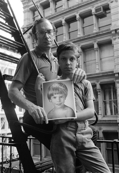 In this May 18, 1985 file photo, Stanly Patz, along with his son Ari, holds a photo of his son Etan, in New York. Etan Patz vanished in 1979 after leaving his family's SoHo home for a short walk to his school bus stop. On Thursday, April 19, 2012, investigators began searching a basement near the Patz's apartment for human remains of the boy. (AP Photo/Ron Frehm, File) abductions;children;crime;disappearance;family;kidnap;photo