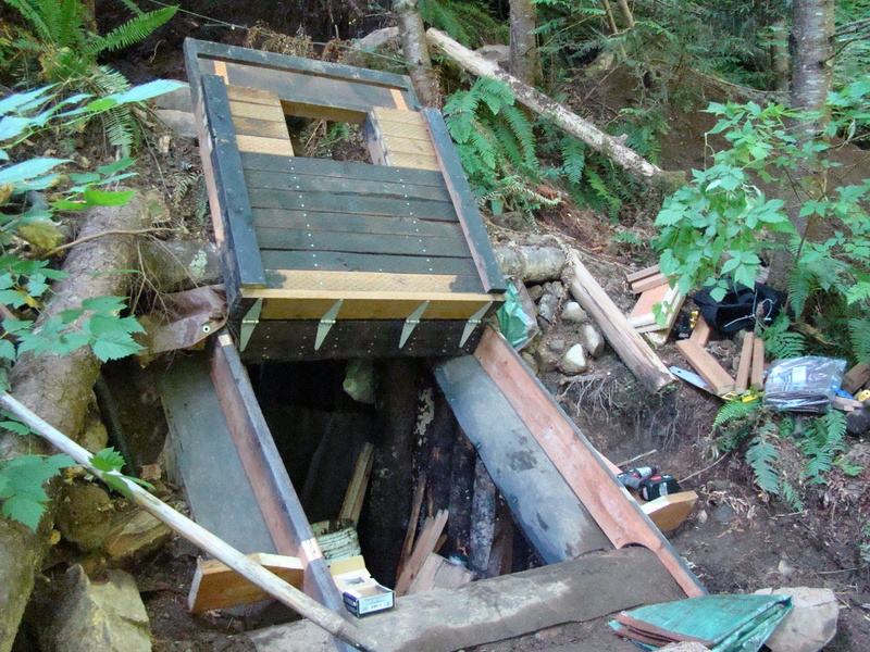 This undated photo shows a bunker in the Cascade foothills east of Seattle that belonged to Peter Keller, a survivalist suspected of killing his wife and daughter. Police blew up the top of the bunker after a 23-hour standoff Saturday and found a body they believe is that of Keller.