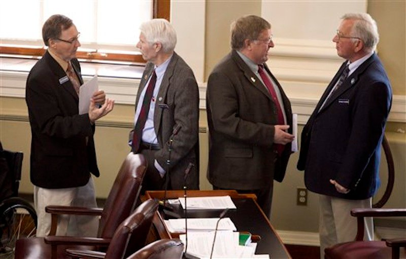 In this April 13, 2012 photo, State Reps., from left: Peter Edgecomb, R-Caribou, Bernard Ayotte, R-Caswell, James Parker, R-Veazie, and Wesley Richardson, R-Warren, confer before the start of a House session, at the State House in Augusta, Maine. Gov. Paul LePage and Maine's Republican-majority Legislature have left their mark on the 2012 election-year session. (AP Photo/Robert F. Bukaty)