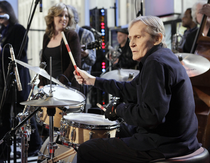 In this Oct. 9, 2009 file photo, Levon Helm, right, performs with his band on the