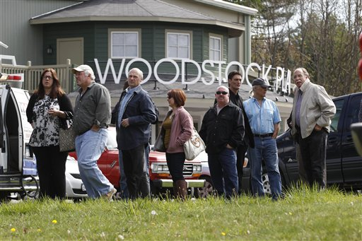 People wait outside the Woodstock Playhouse to board buses to go to a wake for musician Levon Helm at his home today.