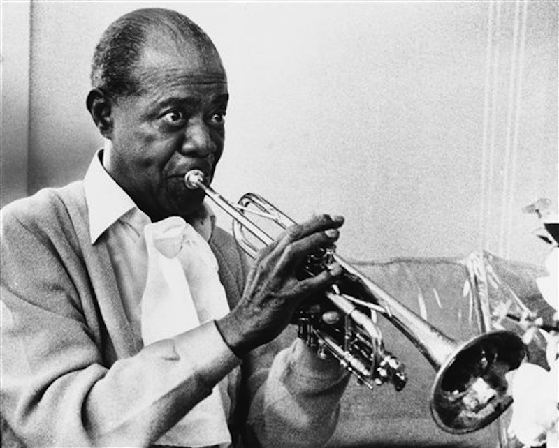 In a June 21, 1971 file photo jazz great Louis Armstrong practices with his horn at his Corona, New York home on June 21, 1971. A live recording of Louis Armstrong playing his trumpet for one of the last times is being played Friday April 27, 2012 at the National Press Club in Washington where it was created in January 1971. (AP Photo/Eddie Adams, File) Looking Away Holding Trumpet Practicing Fame Musician