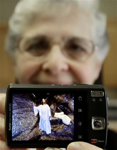 In this April 10, 2012 photo, sister Elaine Lachance holds up her camera displaying a picture she created of a biblical scene, which she intends to use on her blog, at St. Joseph Convent, in Biddeford, Maine. Good Shepherd Sisters of Quebec has just five convents in Maine and Massachusetts with fewer than 60 sisters. The youngest is 64, and it's been more than 20 years since a new member has joined. Sister Lachance is using the Internet, social media and even a blog to attract women who feel the calling to serve God. (AP Photo/Pat Wellenbach)