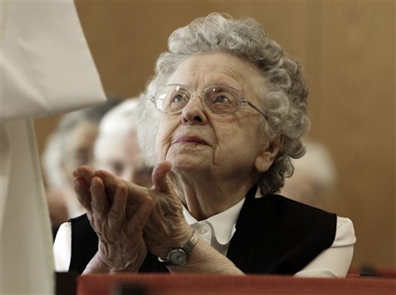 In this April 10, 2012, photo, sister Bertha Duperry, 96, reaches out to take communion during Mass at St. Joseph Convent n Biddeford, Maine. Good Shepherd Sisters of Quebec has just five convents in Maine and Massachusetts with fewer than 60 sisters. The youngest is 64, and itís been more than 20 years since a new member has joined. Sister Elaine Lachance is using the Internet, social media and even a blog to attract women who feel the calling to serve God. (AP Photo/Pat Wellenbach)