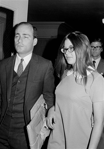 """In this Sept. 23, 1970, file photo, Barbara Hoyt, 19, a former member of Charles Manson's """"family,"""" arrives in court to testify for the prosecution at the trial of Manson and four of his followers for killing actress Sharon Tate and six other people. Hoyt, now a retired registered nurse, and Debra Tate, one of Sharon Tate's sisters, have testified repeatedly at Manson's parole hearings."""