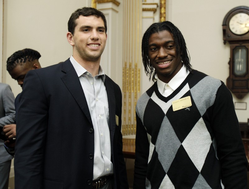 NFL football draft prospects Andrew Luck, left, of Stanford, and Robert Griffin III, of Baylor, attend a reception during their visit to the trading floor of the New York Stock Exchange on Wednesday.