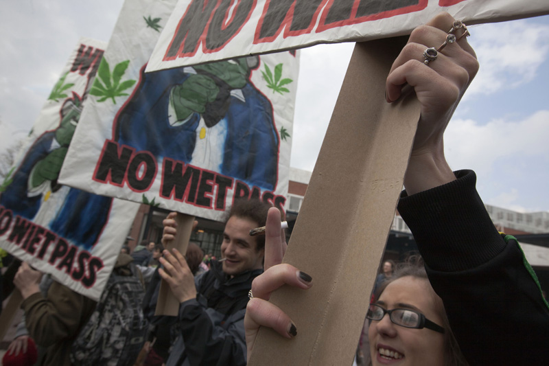 In this recent file photo a woman holds a marijuana joint in Amsterdam during a protest against a government plan to stop foreigners from buying marijuana in the Netherlands.