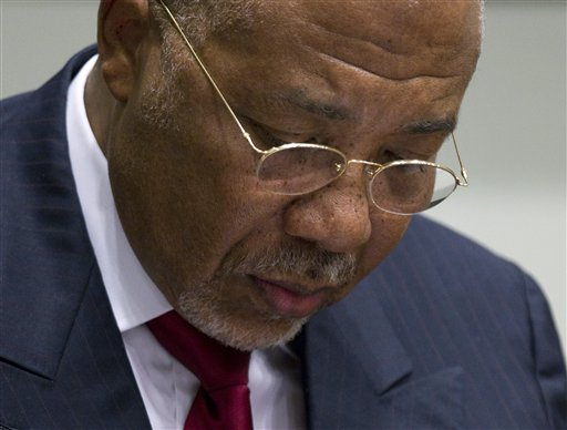 Former Liberian President Charles Taylor looks down as he waits for the start of a hearing to deliver a verdict in Leidschendam, near The Hague, Netherlands.